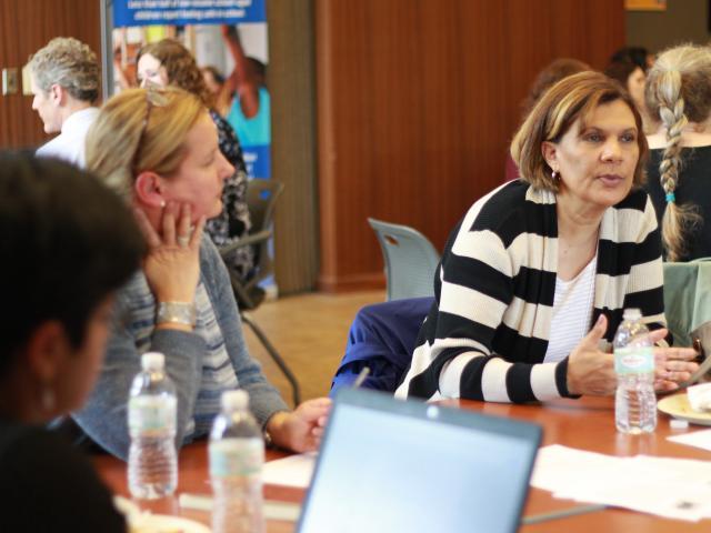 photo of conversation between community & university partners