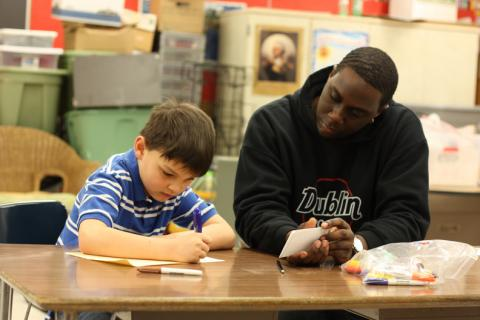 Student tutoring child