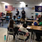 students teaching children