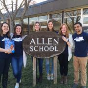 students around Allen School sign