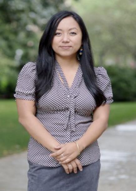Dr. Odessa Gonzalez Benson standing outside.